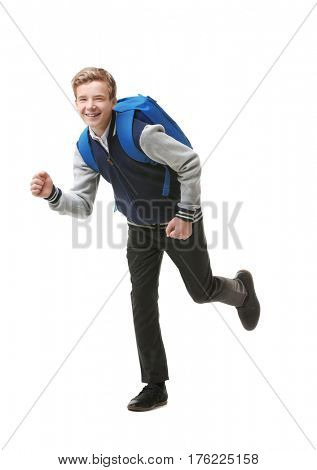 Teenage boy with backpack on white background