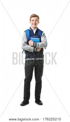 Teenage boy with backpack and books on white background