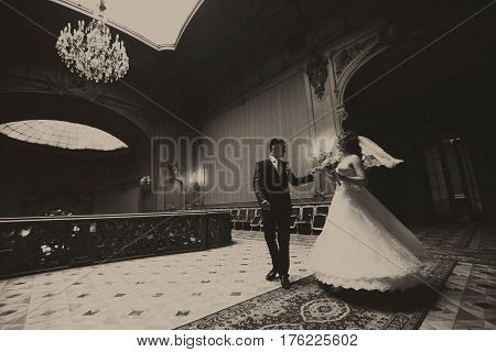 Groom Whirls A Bride In The Centre Of Old Hall