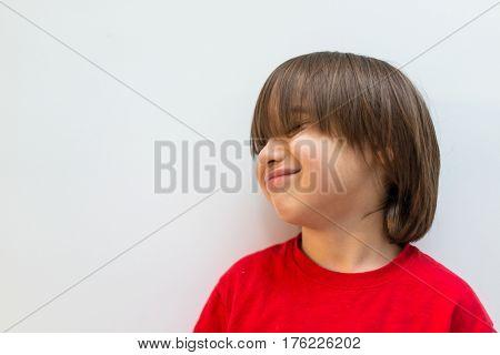Cute little boy posing in studio