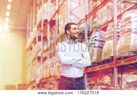 wholesale, logistic, business, export and people concept - happy man at warehouse