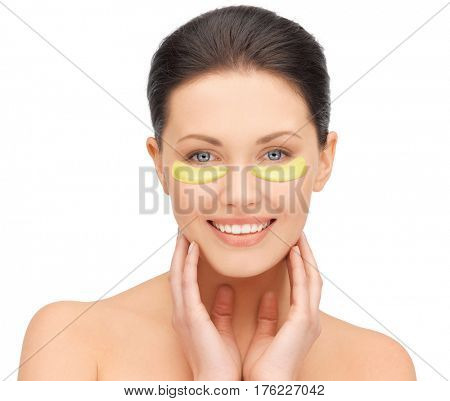beauty, cosmetology, hydration, people and rejuvenation concept - beautiful young woman face with hydrogel under-eye patches over white background
