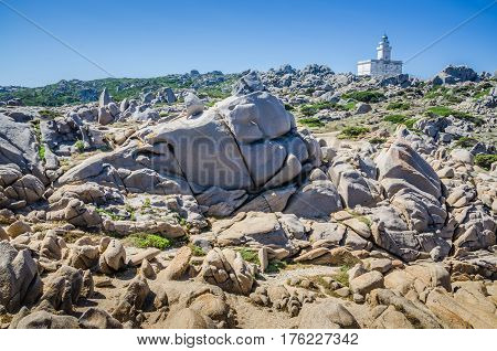 White lighthouse of Capo Testa in north Sardinia, Hudge Granite Rocks in front.