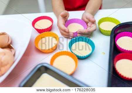 Making cupcakes at home with fun and happiness