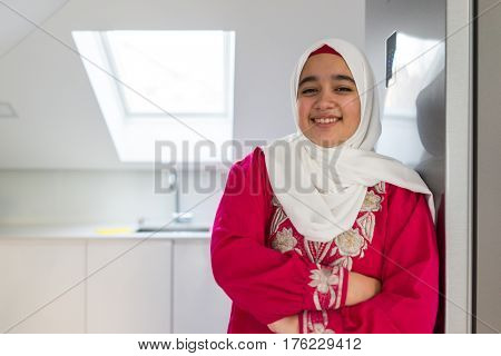 Muslim Arabian girl at home kitchen