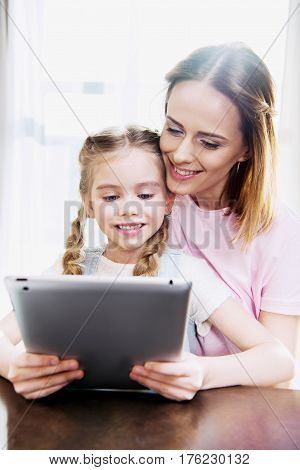 Happy Mother And Daughter Using Digital Tablet At Home