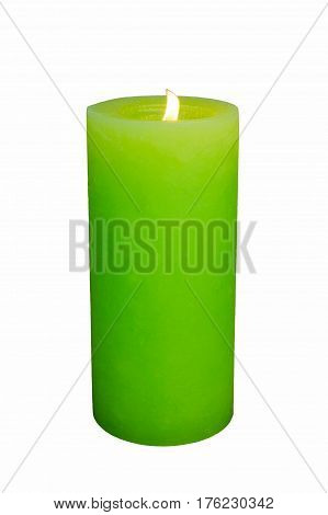 Green lighted paraffin candle with flame close-up on white background