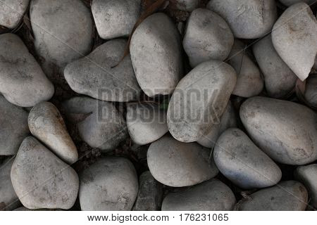 Pebble stones for background. Abstract background and texture with white pebbles. Stones texture and background. Garden decoration.