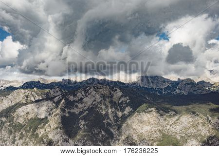 Weather concept. Stormy cloud over high mountain range. Julian Alps, Slovenia.