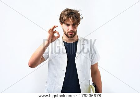 Bearded Caucasian Doctor Or Postgraduate Student With Clipboard