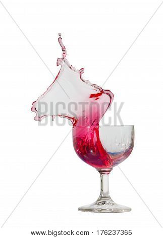 Red splash in a wineglass on a white background