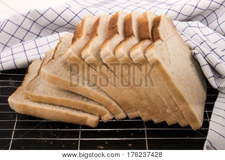 slices of toast bread on a metal cooling rack