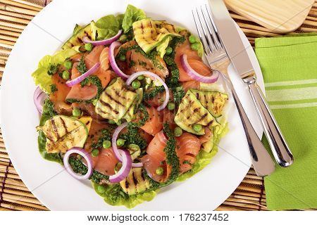 Herbed smoked salmon salad with vegetables. Top view.