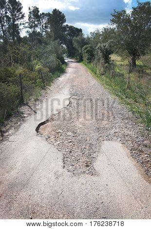 Asphalted Road Becomes Gravel