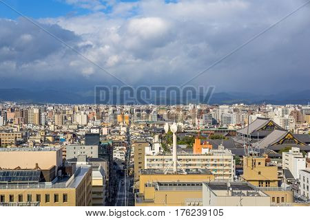 Cityscape of Kyoto city center in cloudy day, Japan.
