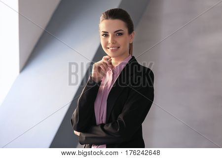 Confident young manager in office