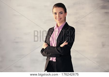 Confident young manager on blurred background