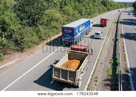 Hatfield, UK - September 2016: Lorries and cars in motion on the  British motorway