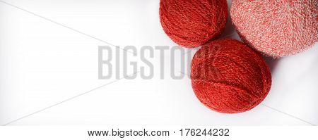 Red and pink tangles of thread for knitting isolated on a white background