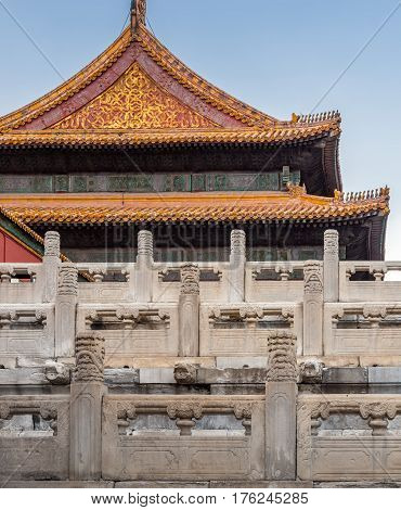 Beijing, China - Oct 30, 2016: Marble balustrades on tiered terraces near a palace in the Forbidden City (Gu Gong, Palace Museum). Note also the ornate roof architecture.