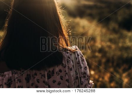 Woman Hipster Hair At Sunset In Summer Field. Back View. Atmospheric Moment. Boho Girl Relaxing In M