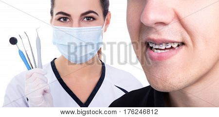 Dentist Or Orthodontist And Young Man With Braces On Teeth
