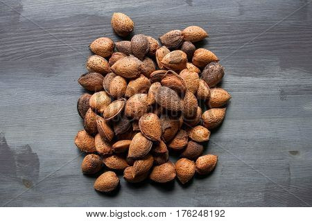 Almonds texture. Almonds background. Shelled spanish almonds. Healthy food. Close up almond background. Abstract background and texture for designers. Close up view of almonds for texture.