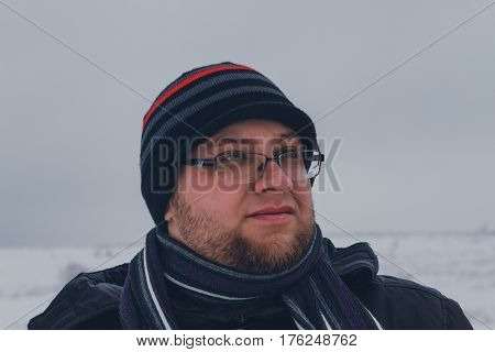 Male Traveler walking in the winter steppe