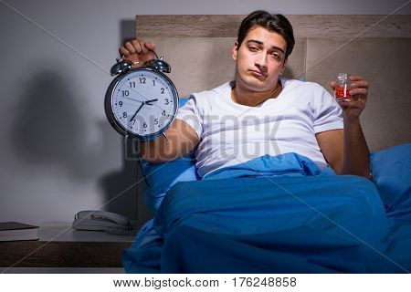 Man taking medical pills from insomnia
