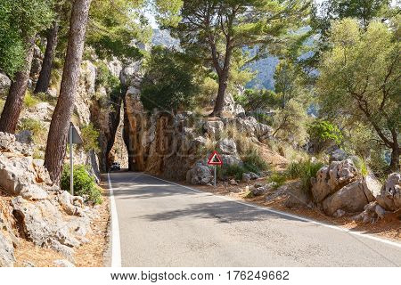Mountain road between the rocks along the sea near the village Sa Calobra. Island Majorca, Spain
