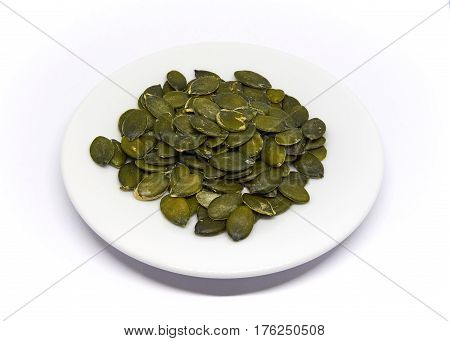 a couple Pumpkin Seeds isolated on white background
