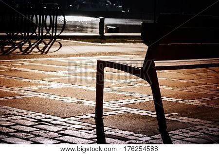 Poland, Szczecin. Original old wooden bench in the city park in the day
