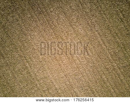 Fallow field; aerial vertical background texture. Aerial drone photo looking down vertically onto a fallow agricultural field; full frame abstract rural background texture.