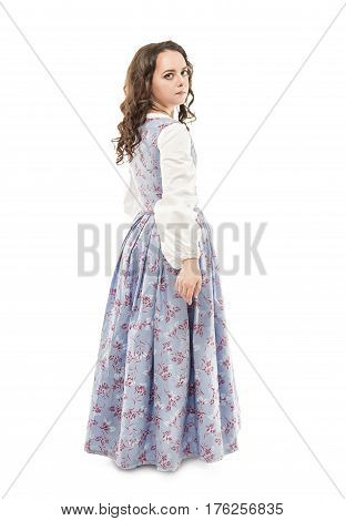 Young beautiful woman in long medieval dress isolated on white