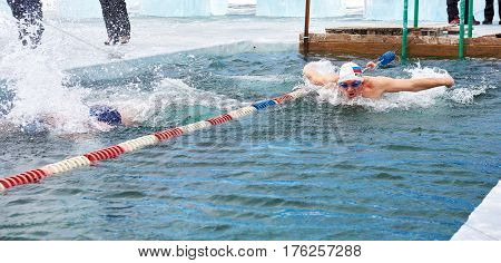 Sahyurta ,, Irkutsk Region, Russia - March 11.2017: Cup Of Baikal. Winter Swimming. Butterfly