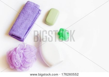Bath products. Purple terry towel, shampoo bottle, soap and toy green frog