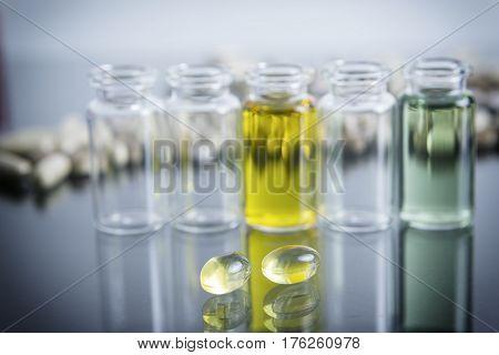 capsules of oil instruments in laboratory, healtcare concept