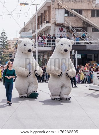 Participant In Carnival Dressed As White Bears Goes Near Viewers