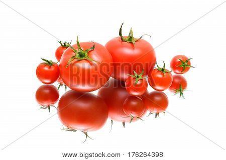 tomatoes close up with reflection on white background. horizontal photo.