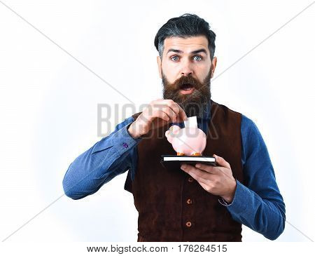 Bearded Man Holding Notepad And Moneybox With Surprised Face