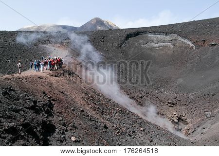People Hiking At Mount Etna On The Island Of Sicily