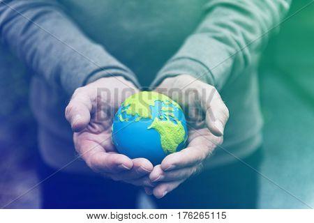 Hands holding environmental conservation globe