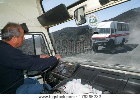 Mount Etna Italy - 15 July 2008: Driver of a tourist bus of mount Etna on Sicily Italy