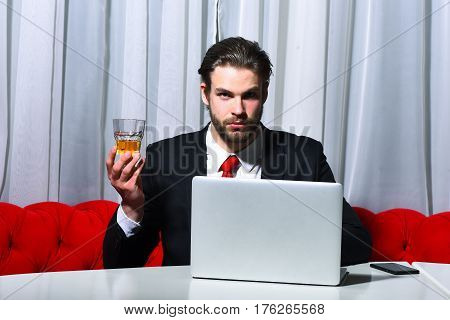 Bearded Man, Businessman Holding Glass Of Whiskey Works At Laptop