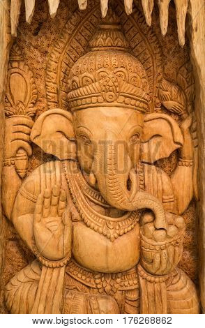wood carving for Hindu god Ganesha on the wood.