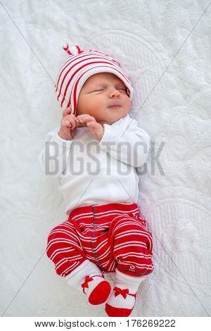 Newborn baby smiling in sleep. Close up