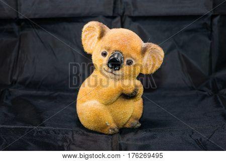 a fuzzy koala bear bank for saving money