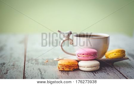 Multicolored Macaroon And Coffe Cup