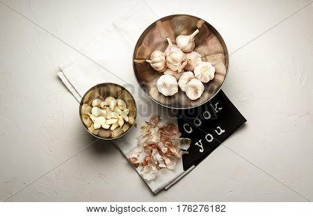 Garlic. Garlic Cloves And Garlic Bulb Over White Stone Background
