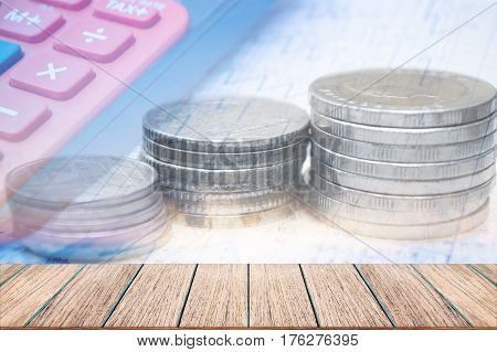 Double exposure coins with calculator Saving money Empty wood table top Economy Investment and Saving Concept.